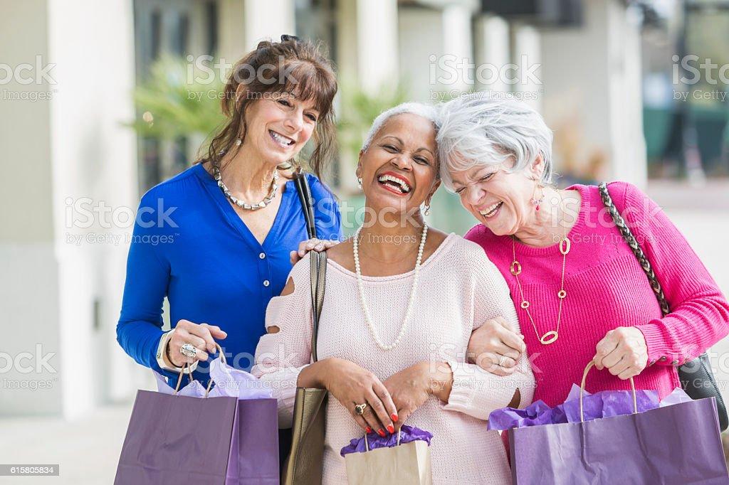 Three multi-ethnic senior women out shopping stock photo