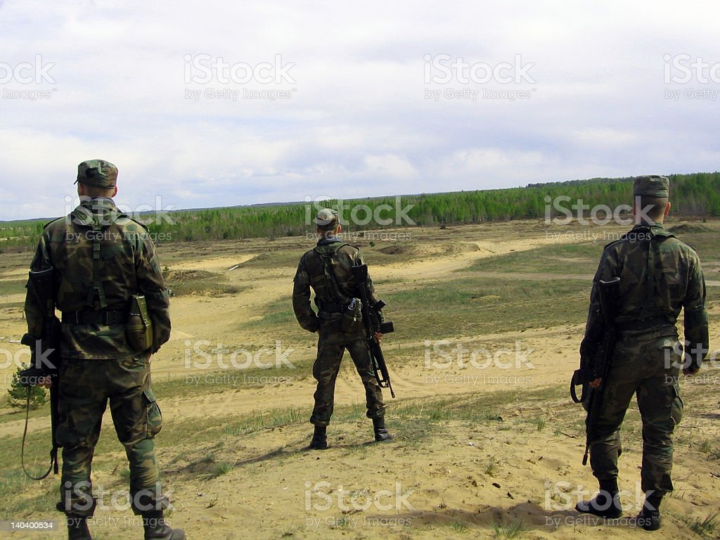 Three Nato solders on a range royalty-free stock photo