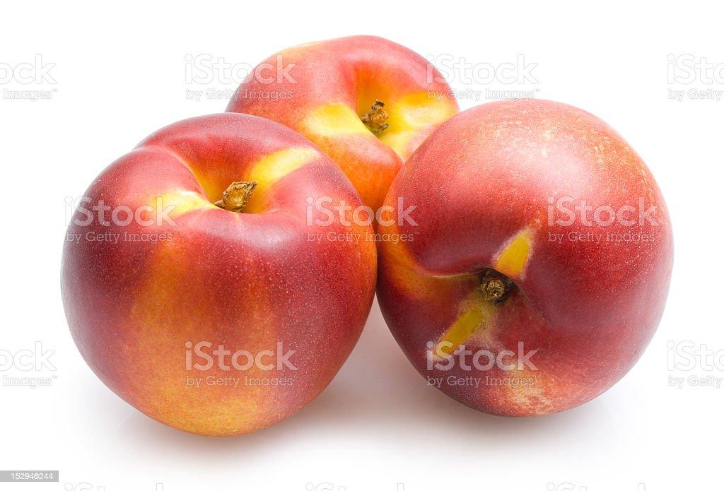 Three nectarines on a white background royalty-free stock photo