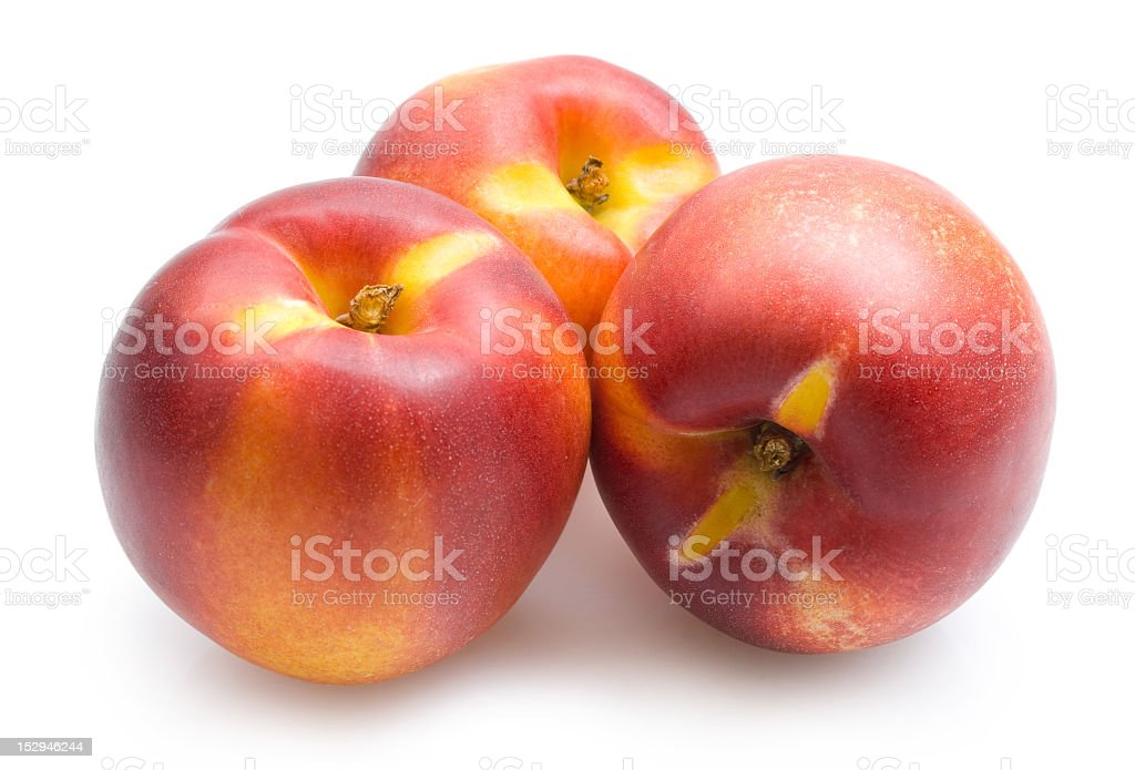 Three nectarines on a white background stock photo