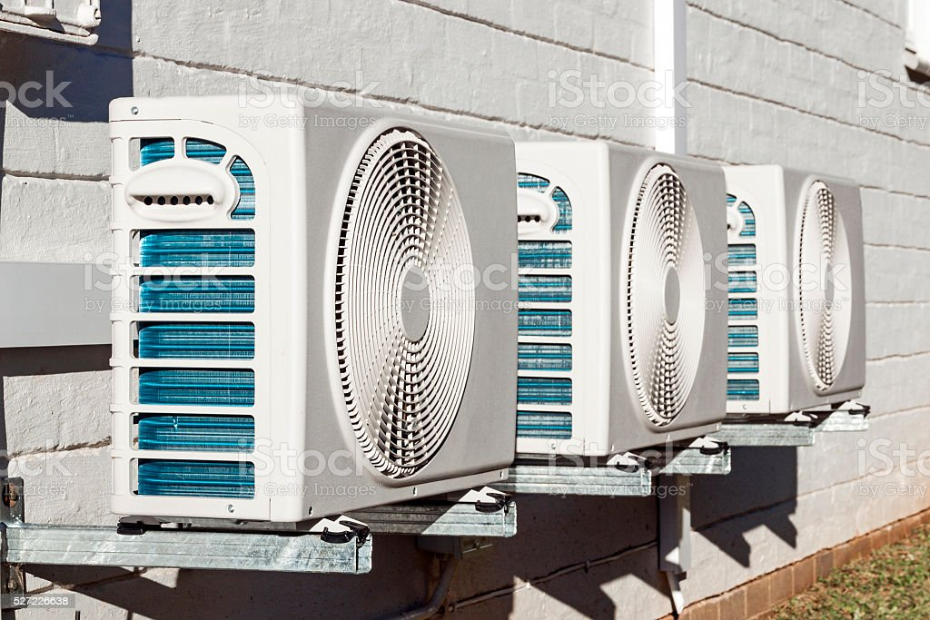 Three Newly Installed Airconditioning Units Mounted on Wall stock photo