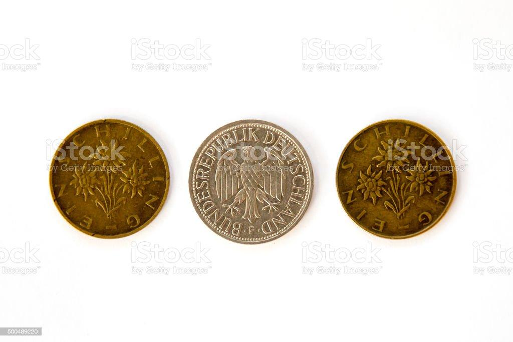 Three obsolete coins, Austrian schillings and Deutsche Mark stock photo