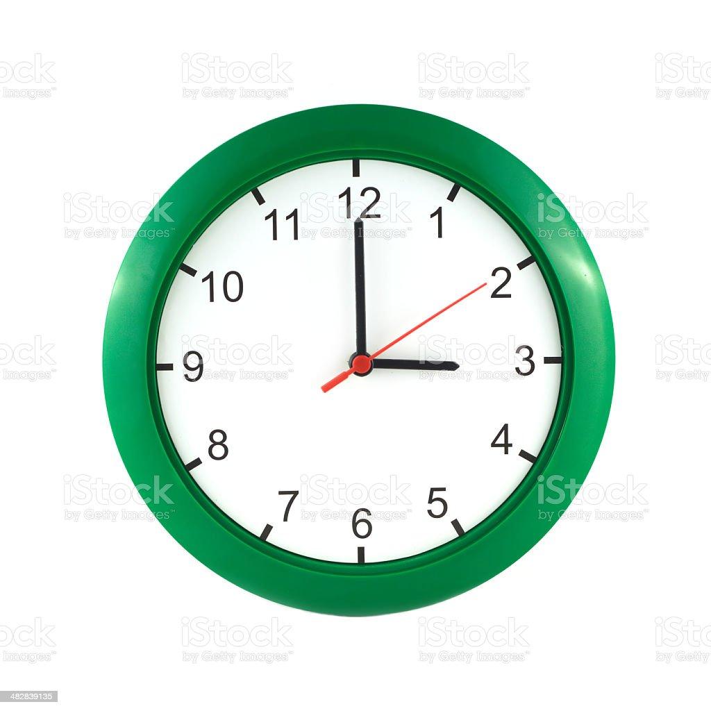 Three o'clock  on green wall clock stock photo