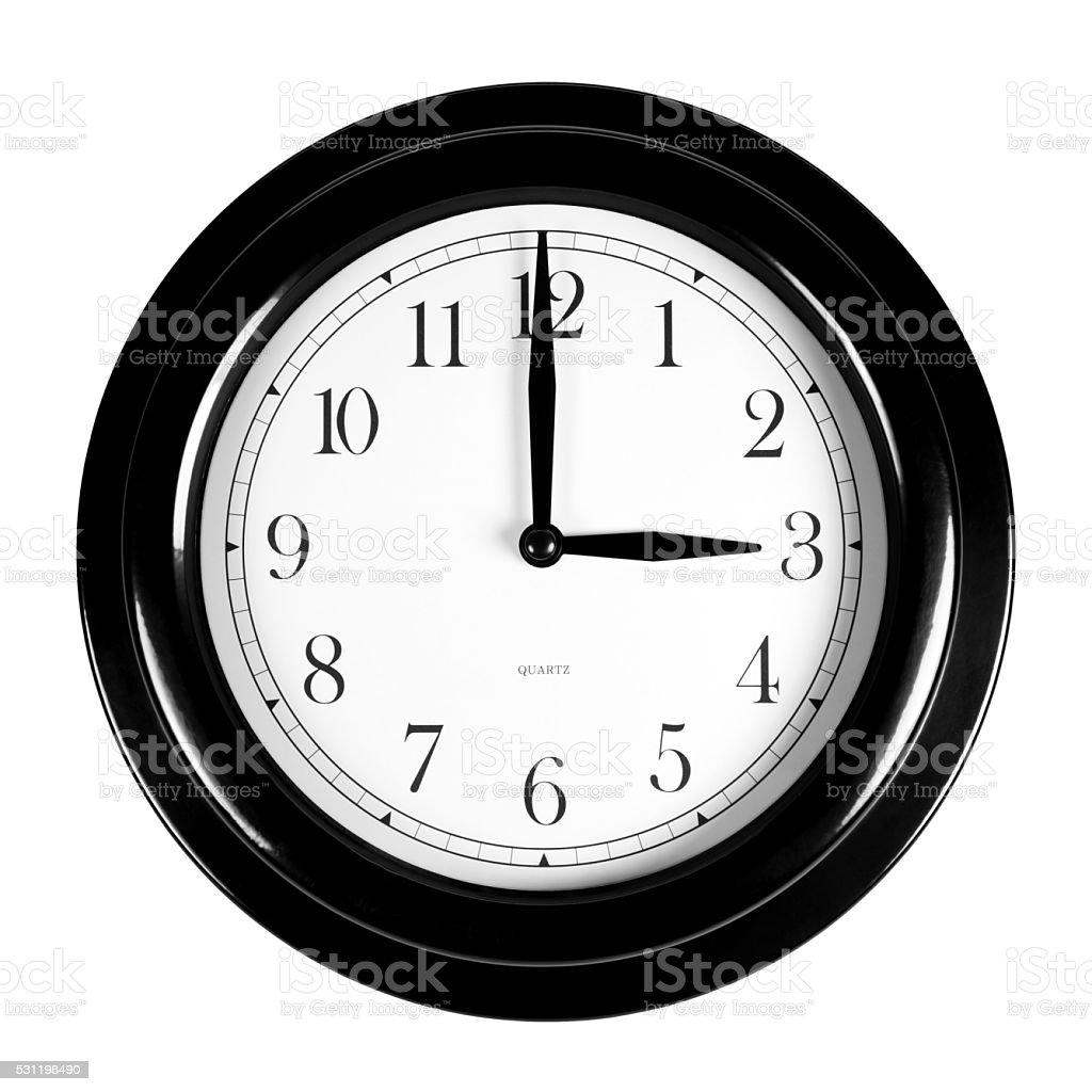 Three o'clock on the black wall clock stock photo