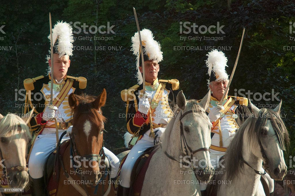 Three officers on horses during procession in Florennes stock photo