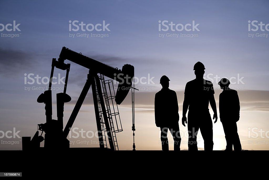 Three Oil Workers and an Pumpjack stock photo