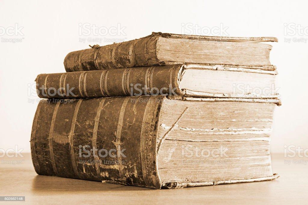 Three old books stock photo
