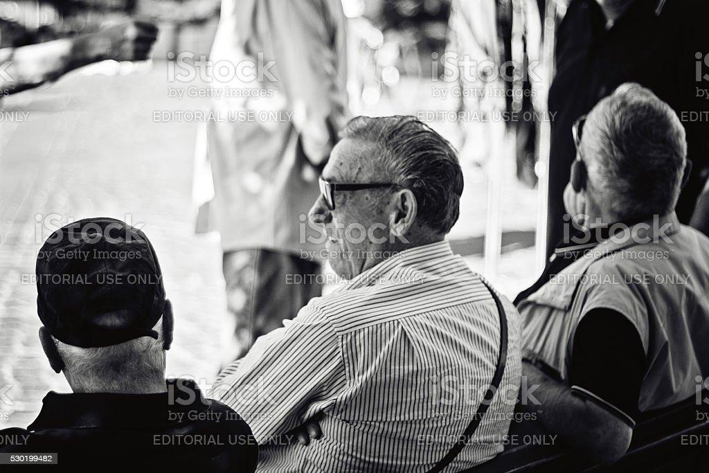 Three Old Italian Men Sitting On a Bench stock photo