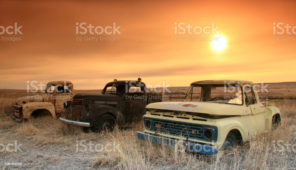 Three Old Trucks on the Plains stock photo