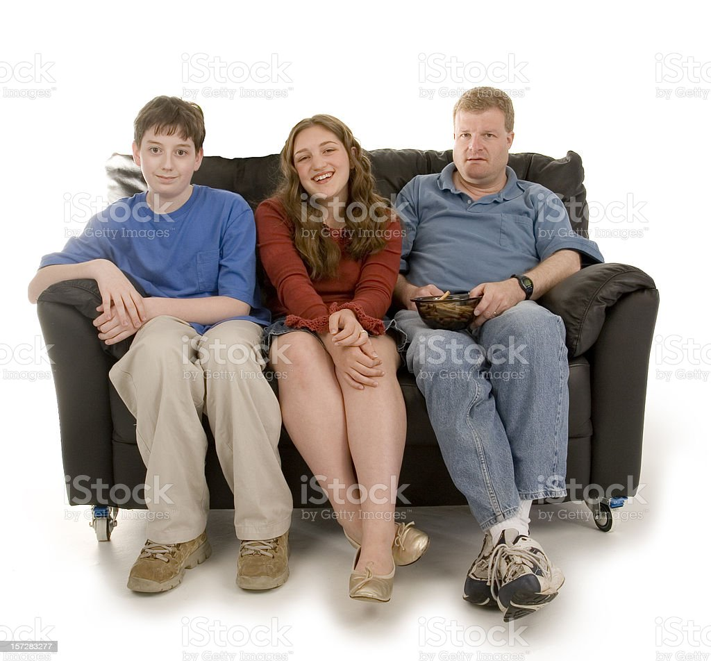 Three on a couch royalty-free stock photo