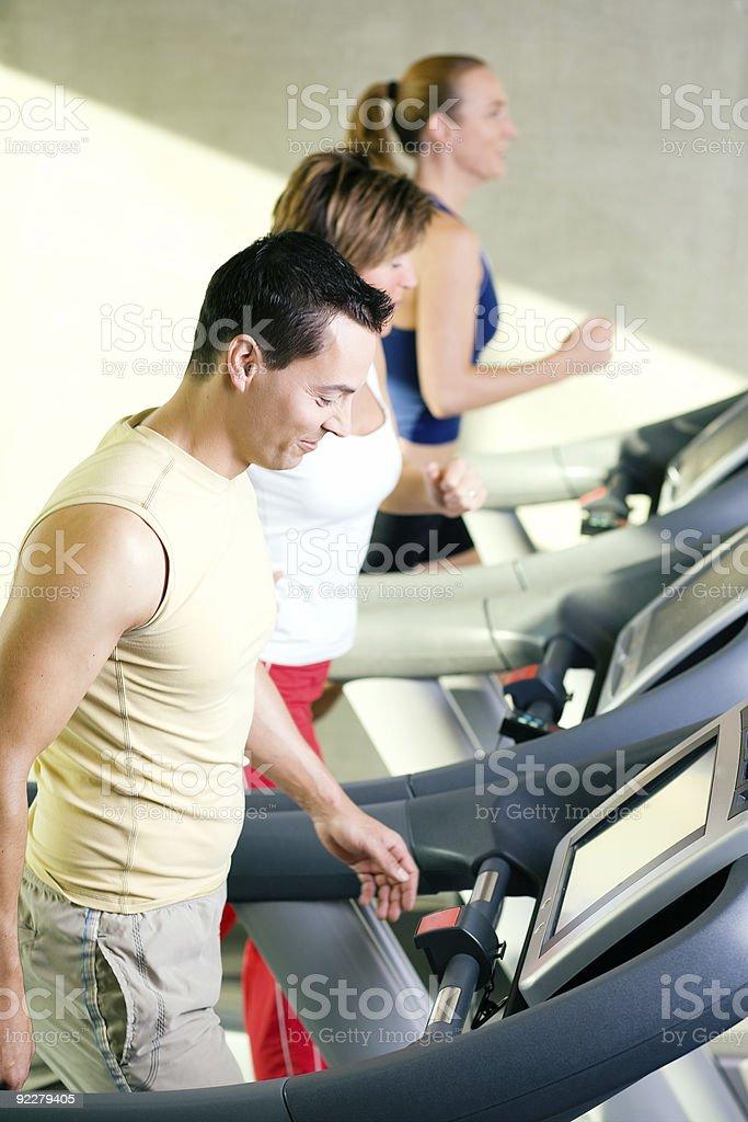 Three on the treadmill royalty-free stock photo