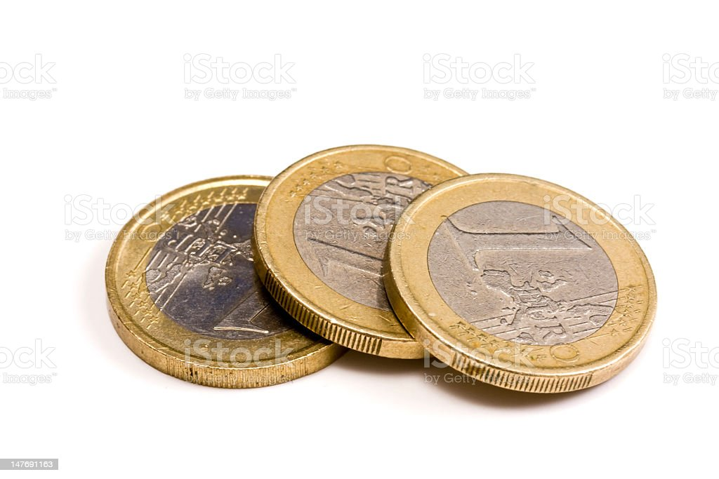 Three one euro coins on a white background royalty-free stock photo