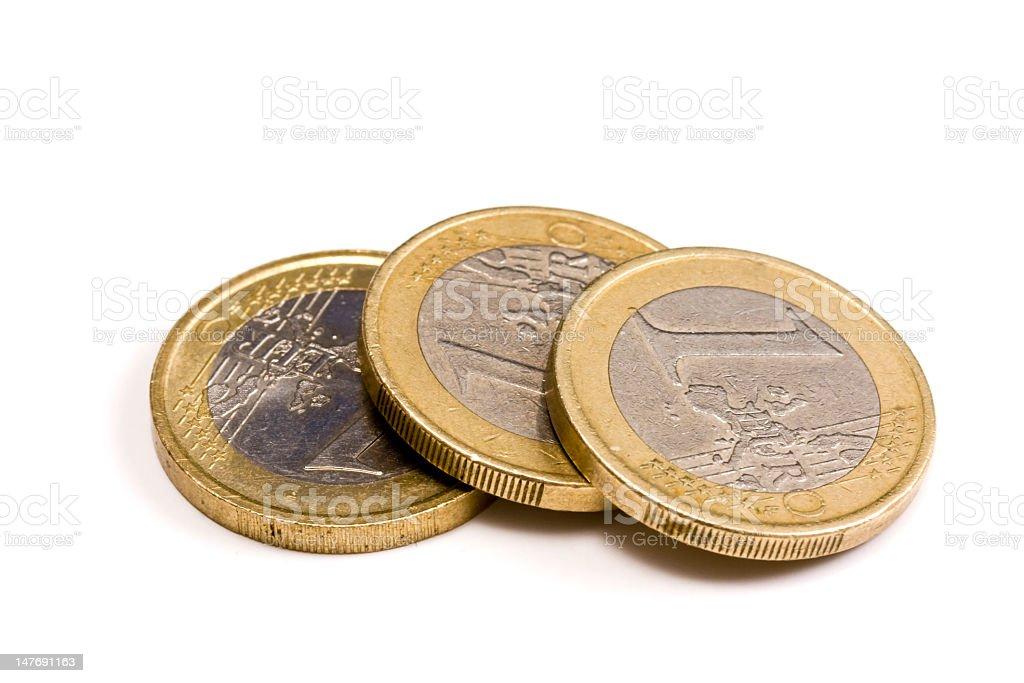 Three one euro coins on a white background stock photo