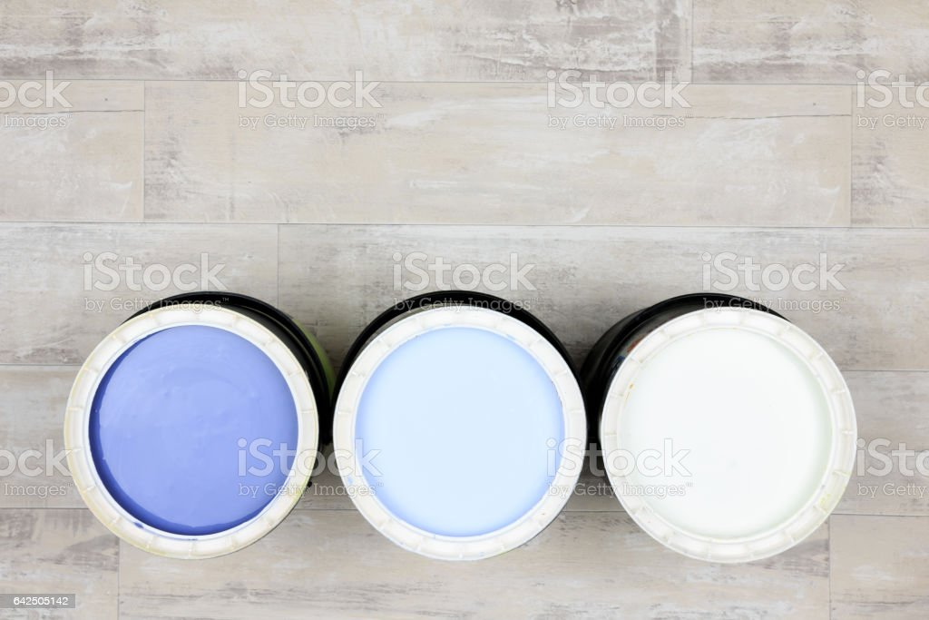 Three open paint cans with colour paint stock photo