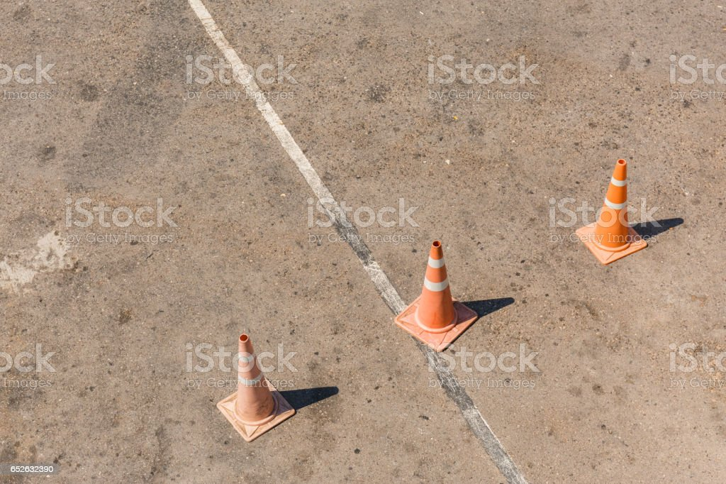 Three Orange road hazard cones stock photo
