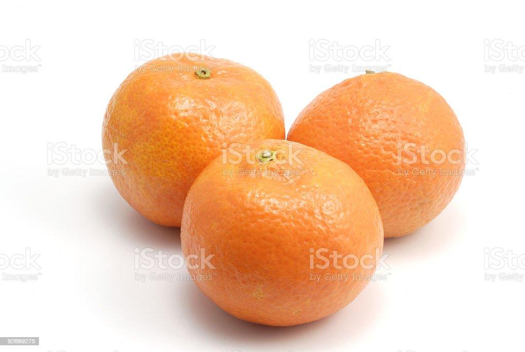Three orange tangerines royalty-free stock photo