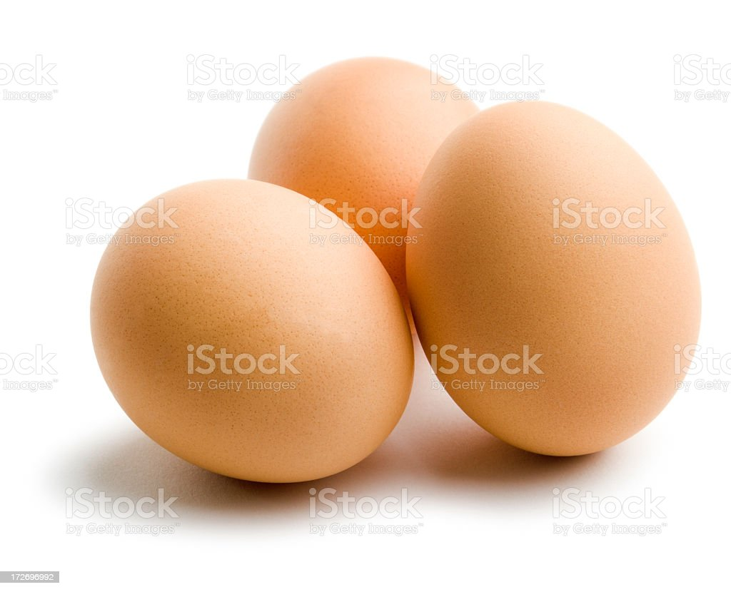 Three Organic Brown Eggs, Fresh Dairy Food Isolated on White stock photo