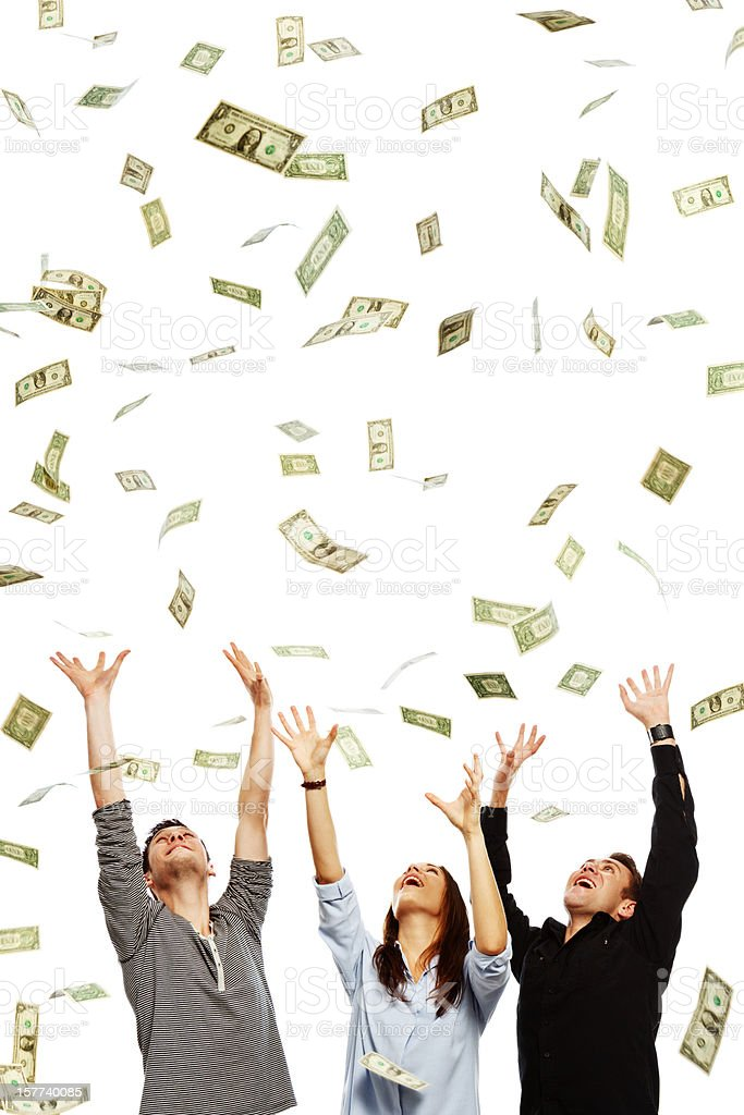 Three overjoyed young adults being showered with dollars stock photo