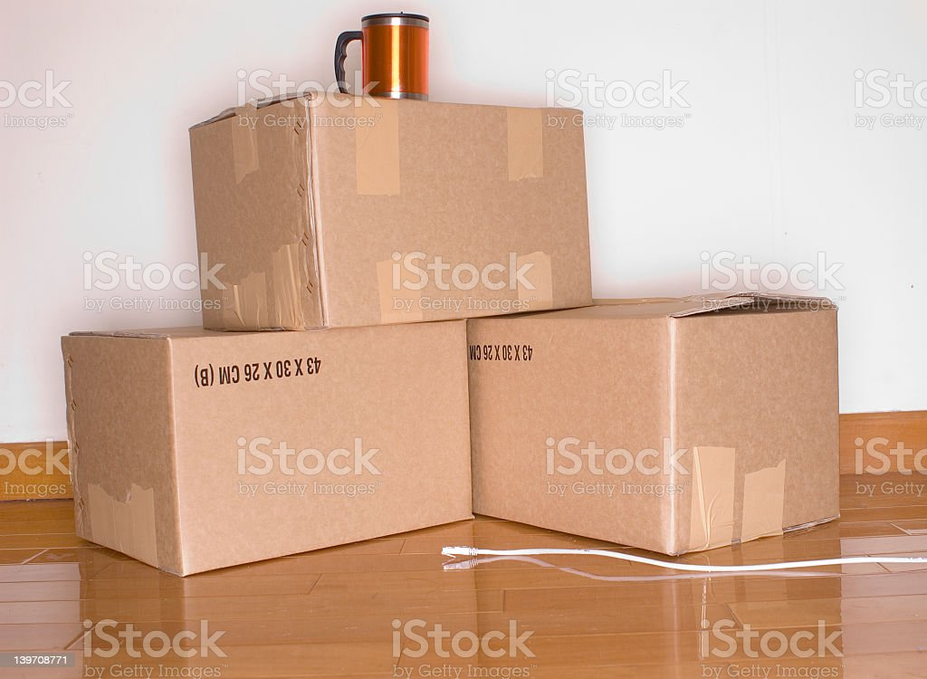 Three packed cardboard boxes with coffee mug and charger royalty-free stock photo