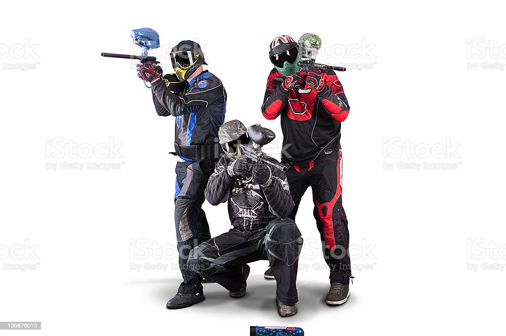 Three paintball team members with helmets and guns stock photo
