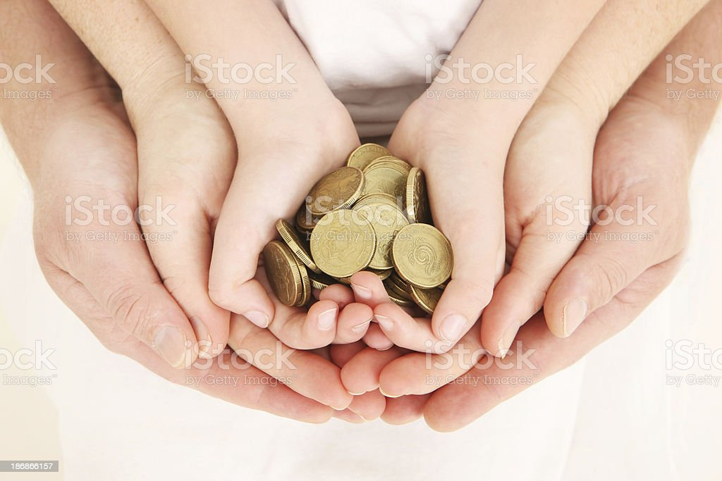 Three pairs of concentric hands with gold coins stock photo