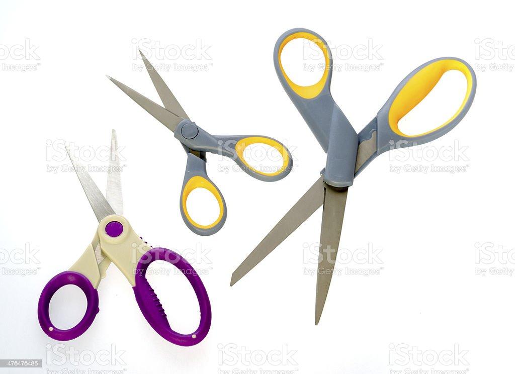 Three pairs of different sized scissors stock photo