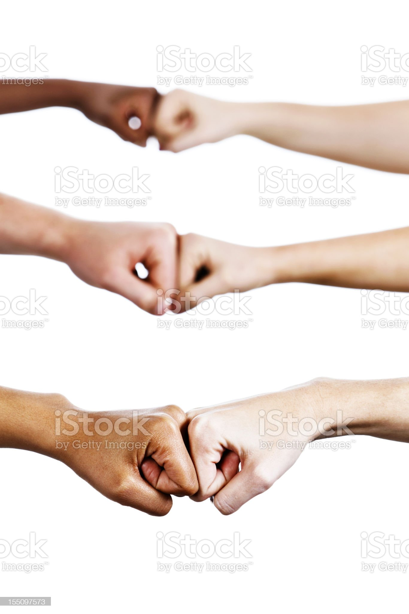 Three pairs of hands bump fists in agreement or greeting royalty-free stock photo