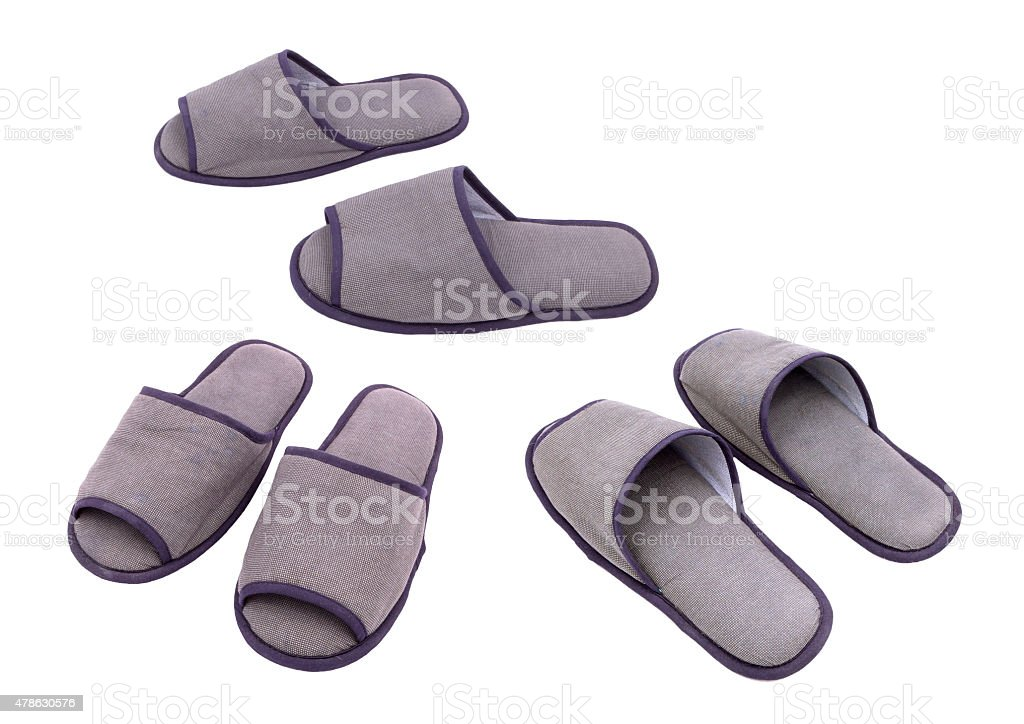 Three pairs of slippers isolated against white background stock photo