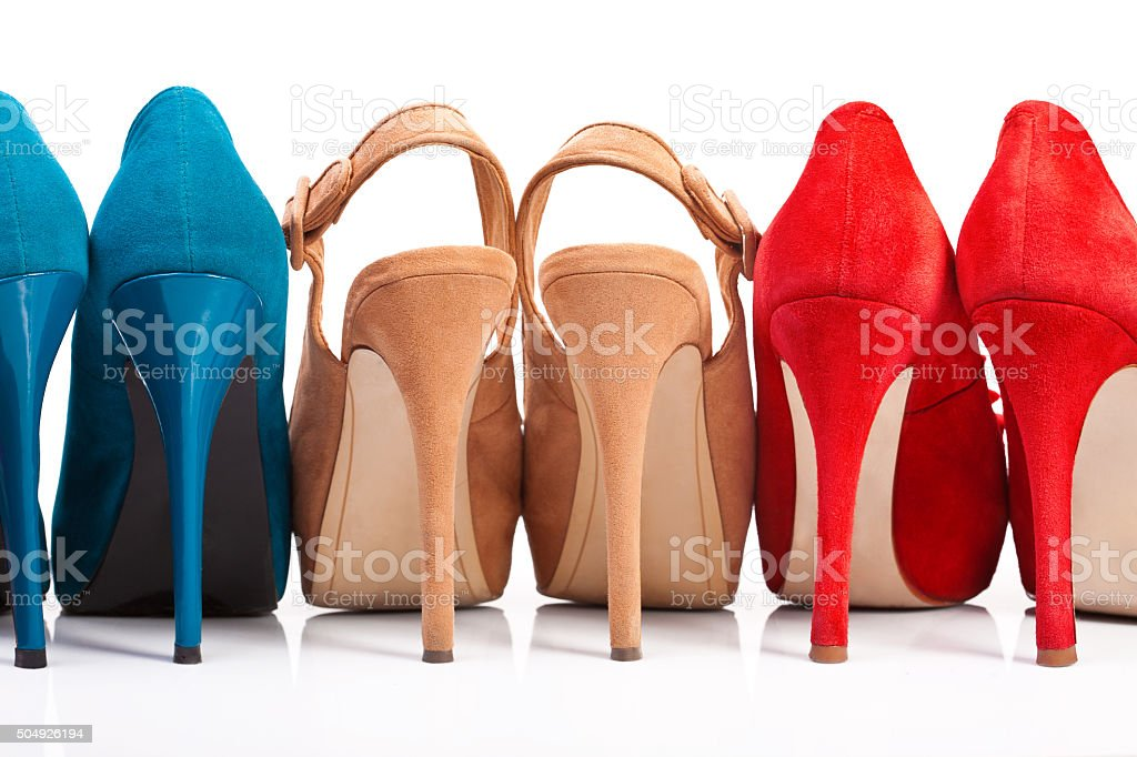 Three pairs of women's shoes with stock photo