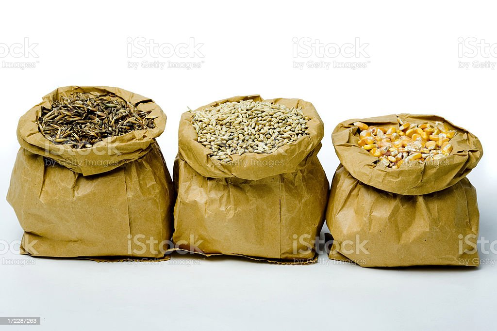 three paper bags full of cereal stock photo