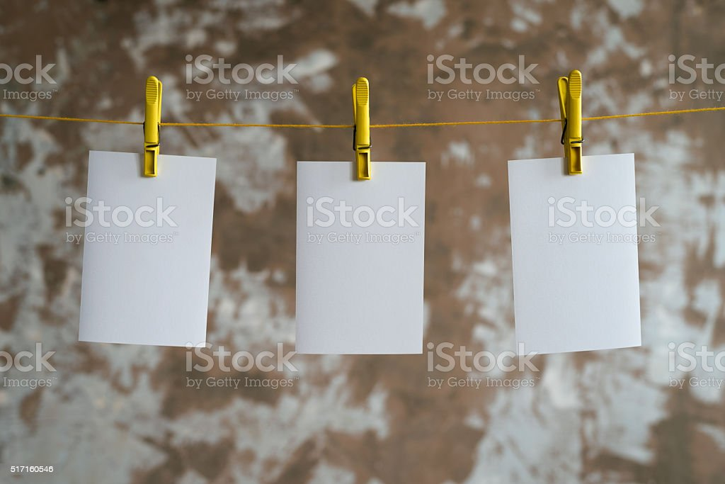 Three paper cards hanging on the rope stock photo