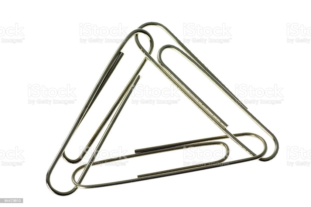 Three paper clips interlinked royalty-free stock photo