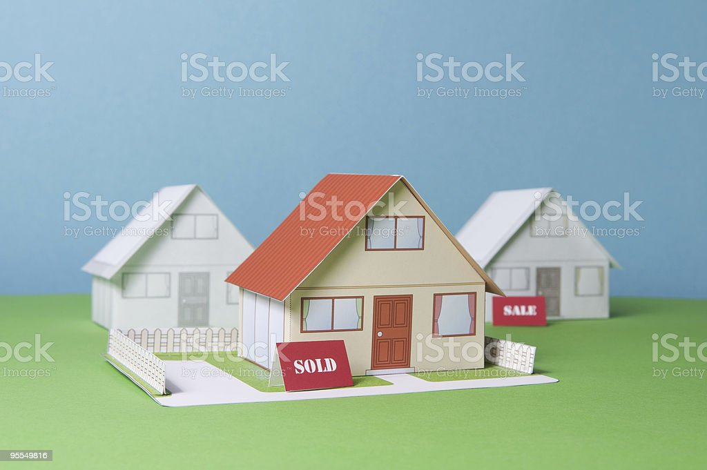 Three  paper made houses stock photo