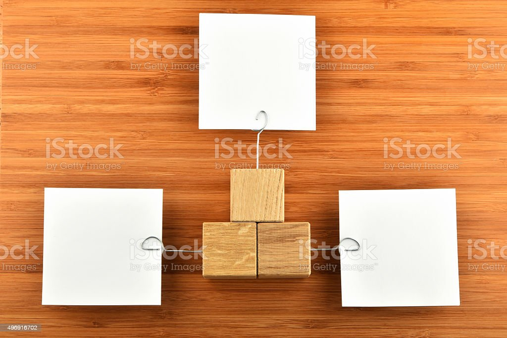 Three paper notes with holders in different directions on wood royalty-free stock photo