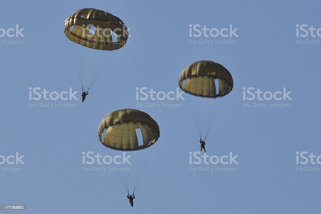 three paratroopers in the air stock photo