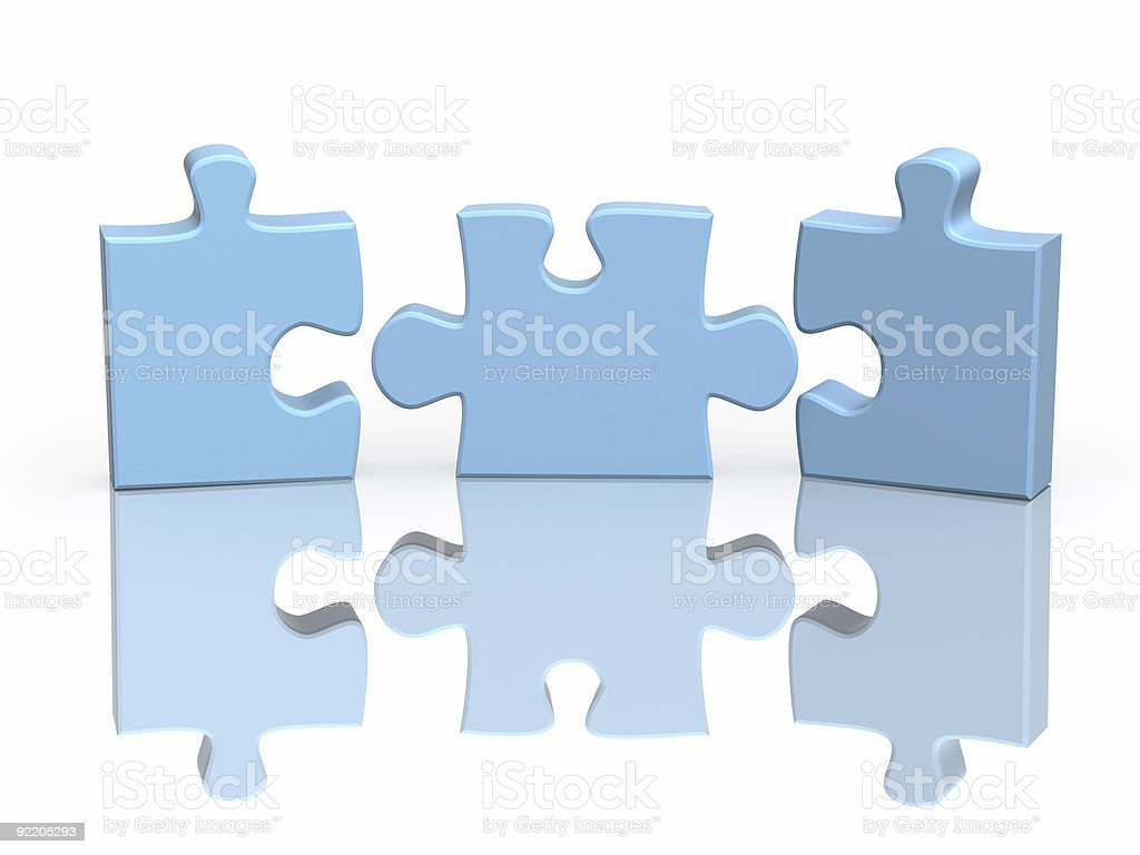 Three parts of a puzzle standing near each other royalty-free stock photo