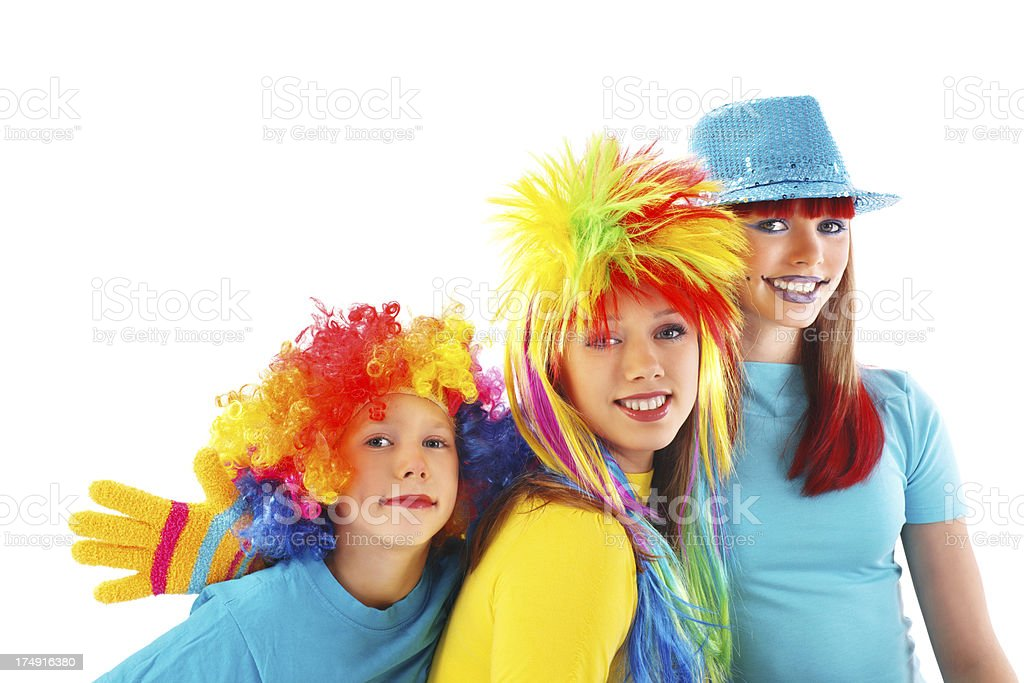 Three party girls wearing costumes are looking at the camera. royalty-free stock photo