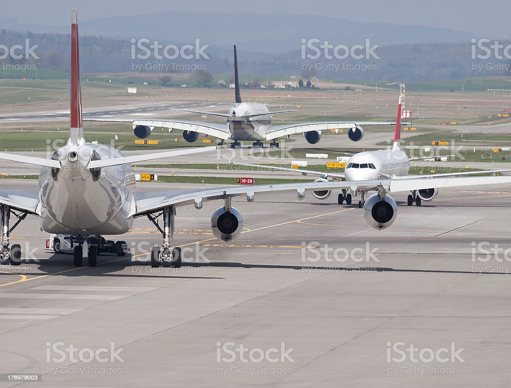 Three passenger aircrafts in heavy traffic on the ground stock photo