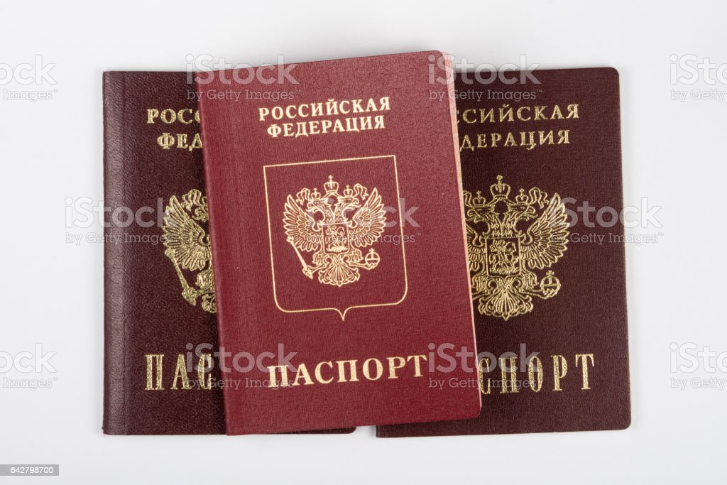 Three passport of the citizen of the Russian Federation on a white background stock photo