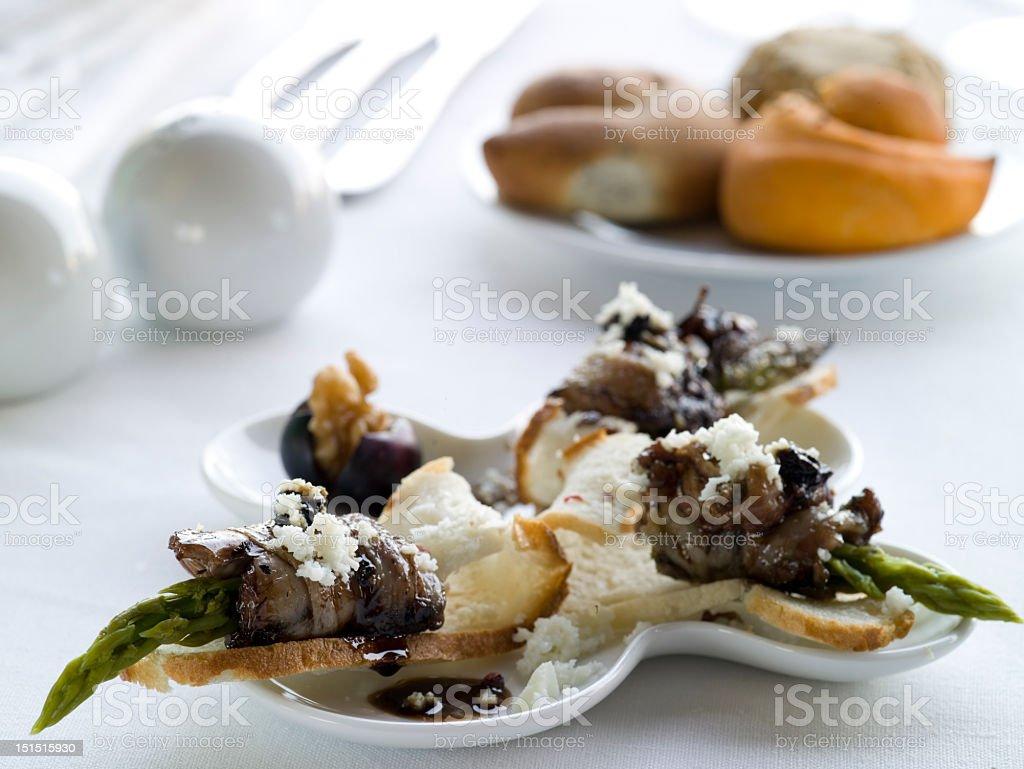 Three peaces Quail  rolls with asparagus stock photo