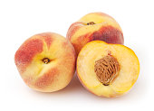 Three peaches isolated on white background with clipping path