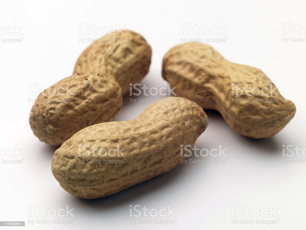 Three Peanuts stock photo