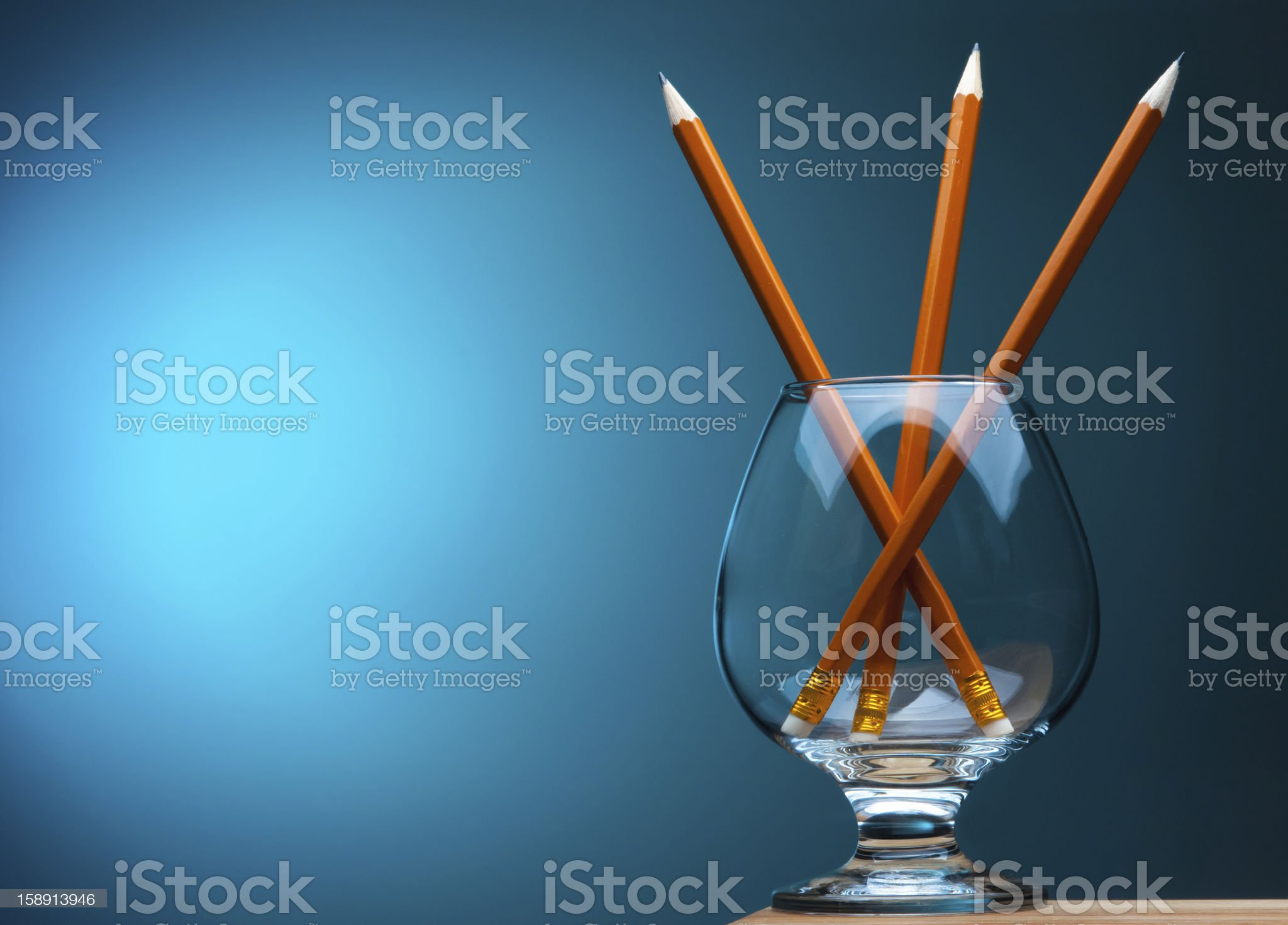 three pencils in a wineglass royalty-free stock photo