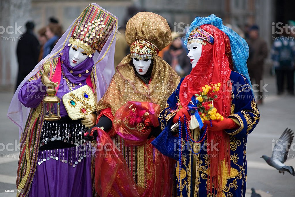 Three people are dressed for the Carnivale in Venice,Italy stock photo