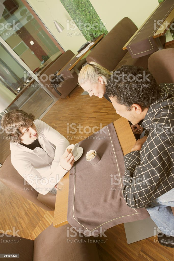 Three people coffee shop talk royalty-free stock photo