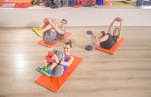 Three people happy smiling fitness mat happy abs core exercise