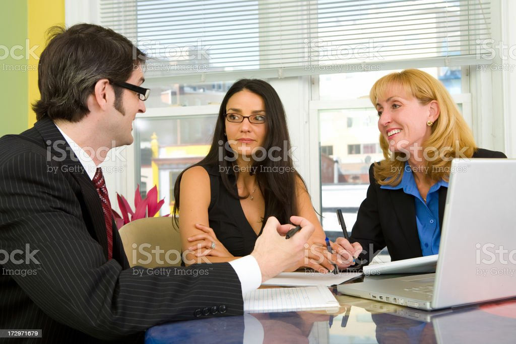 Three people have a business meeting royalty-free stock photo