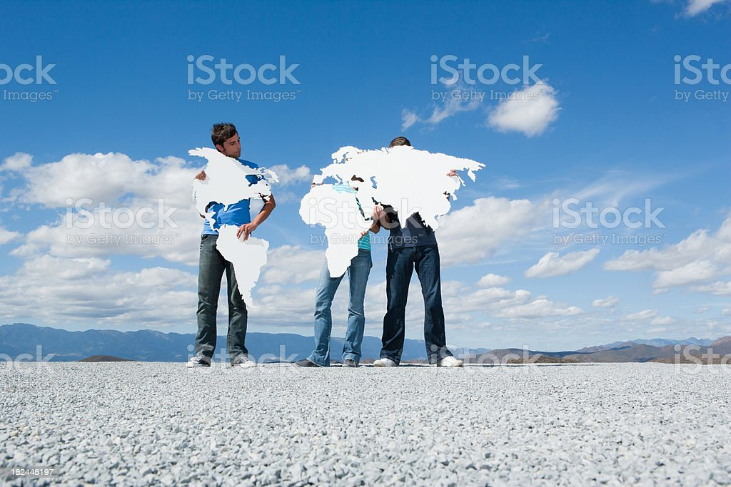 Three people holding continents stock photo