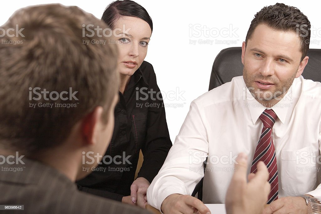 Three people in a business meeting royalty-free stock photo