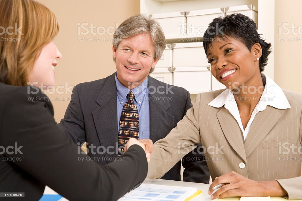 Three people involved in a business interview royalty-free stock photo